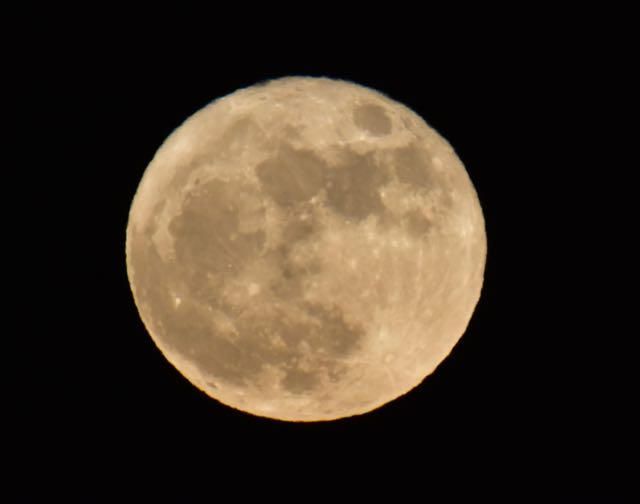 Different camera settings of the Super Moon on the night after the full moon.